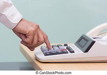 businessman press button calculater