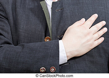 businessman presses his hand to heart - hand gesture