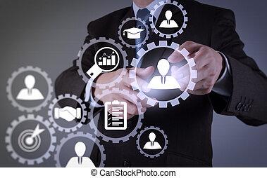 Businessman pressing an imaginary button on virtual screen