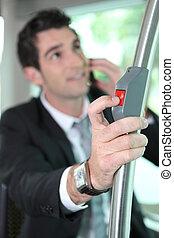 Businessman pressing button on bus