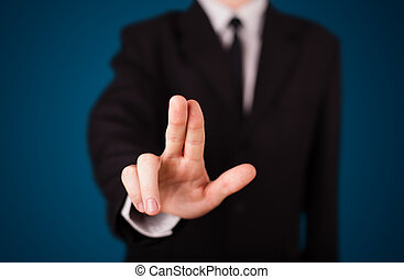 Businessman pressing imaginary button - Young businessman...