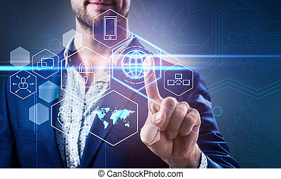 Businessman pressing on virtual icons in cyberspace.