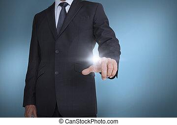Businessman pressing something