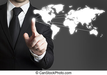 businessman pressing touchscreen worldmap - businessman in...