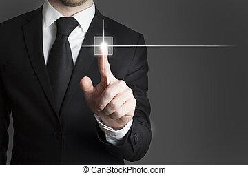 man in black suite pressing virutal button