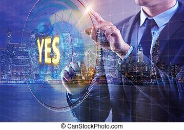 Businessman pressing virtual button YES