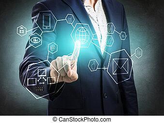 Businessman pressing virtual icons.