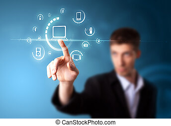 Businessman pressing multimedia type of modern buttons with virtual background