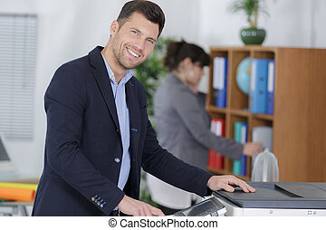 businessman printing and scaning a document
