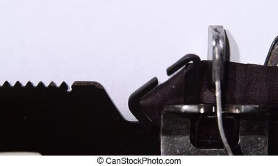 Businessman prints word marketing on retro typewriter. Close up