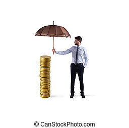 Businessman protects his money savings with umbrella. concept of insurance and money protection