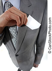 Businessman pulling a business card out of his pocket