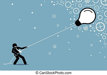 Businessman pulling a flying floating light bulb on a string.