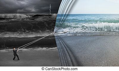 businessman pulling open calm sea curtain covered dark...