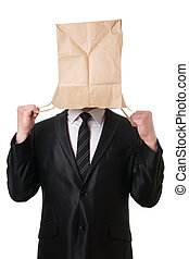 businessman pulling paper bag over his head