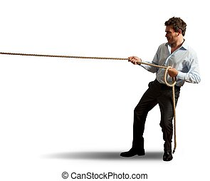 Businessman pulling rope