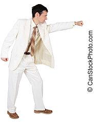 Businessman punching, isolated on white background