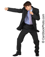 Businessman punching on white background