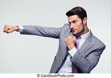 Businessman punching