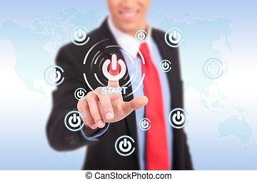 businessman push the start button