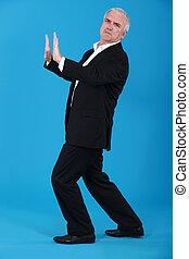 Businessman pushing against empty copyspace