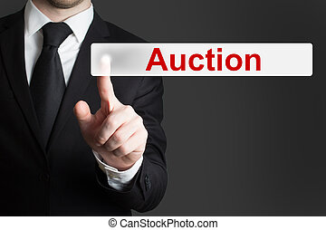 businessman pushing button auction