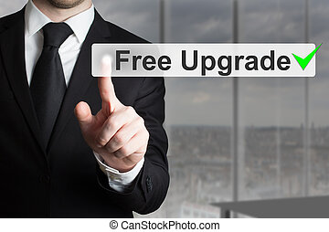 businessman pushing button free upgrade - businessman in...