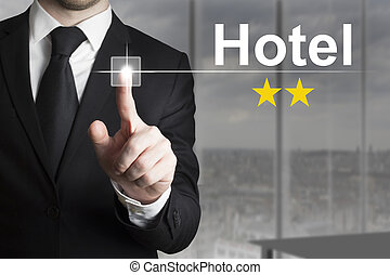 businessman pushing button hotel two stars