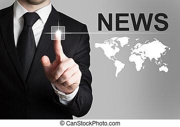 businessman pushing button news worldmap - businessman in...