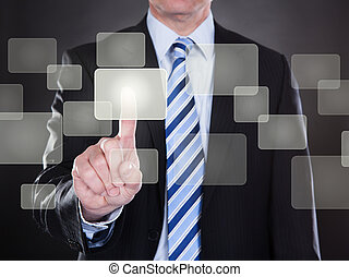 Businessman Pushing Button On Transparent Screen