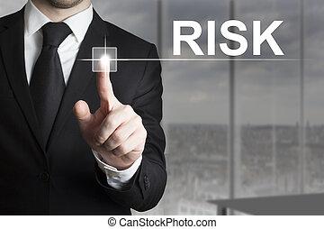 businessman pushing button risk