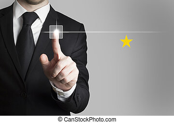 businessman pushing button star rating