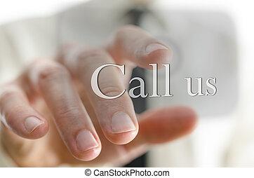 Businessman pushing Call us button on a virtual screen