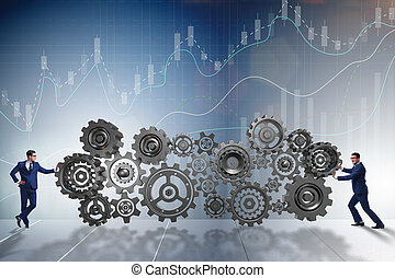 Businessman pushing cog wheels in business concept