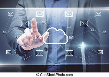 Businessman pushing creative glowing cloud email map