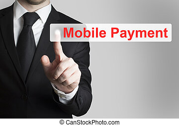 businessman pushing flat button mobile payment - businessman...