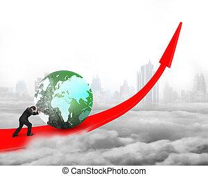 Businessman pushing globe upward on red trend line, on gray...