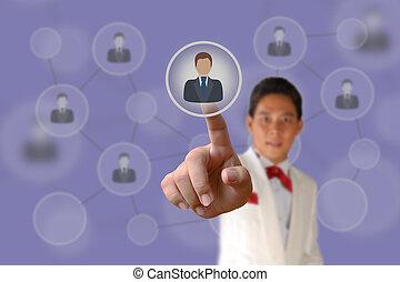 Businessman pushing human button