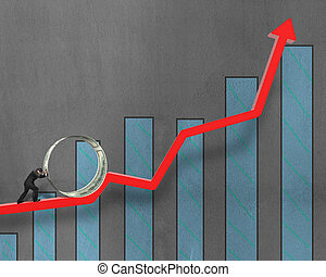 Businessman pushing money circle on growing red arrow with chart on concrete wall