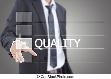 Businessman pushing Quality word. - Image for business and...