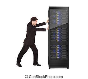 Businessman pushing server rack. Isolated on white