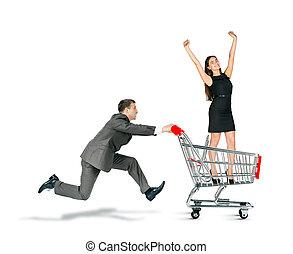 Businessman pushing shopping cart