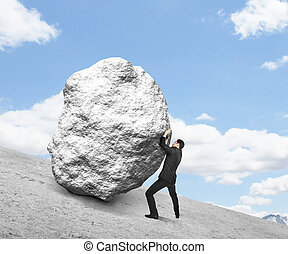 businessman pushing stone up hill and sky
