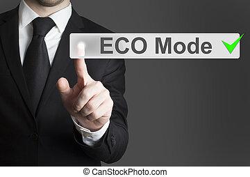 businessman pushing touch screen button eco mode