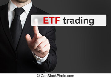 businessman pushing touchscreen button etf trading
