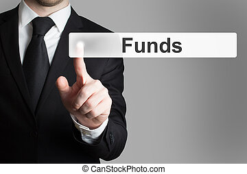 businessman pushing touchscreen button funds