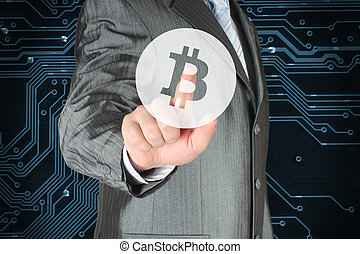 Businessman pushing virtual button with Bitcoin symbol