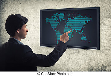 businessman pushing world map interface
