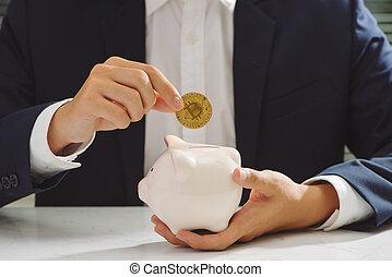Businessman put bitcoin to piggy bank, bit coin BTC the new virtual electronic money, investment concept