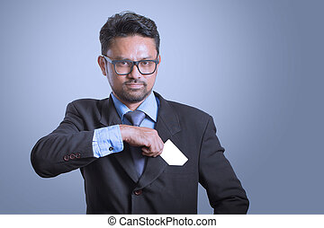 businessman putting credit card to the pocket